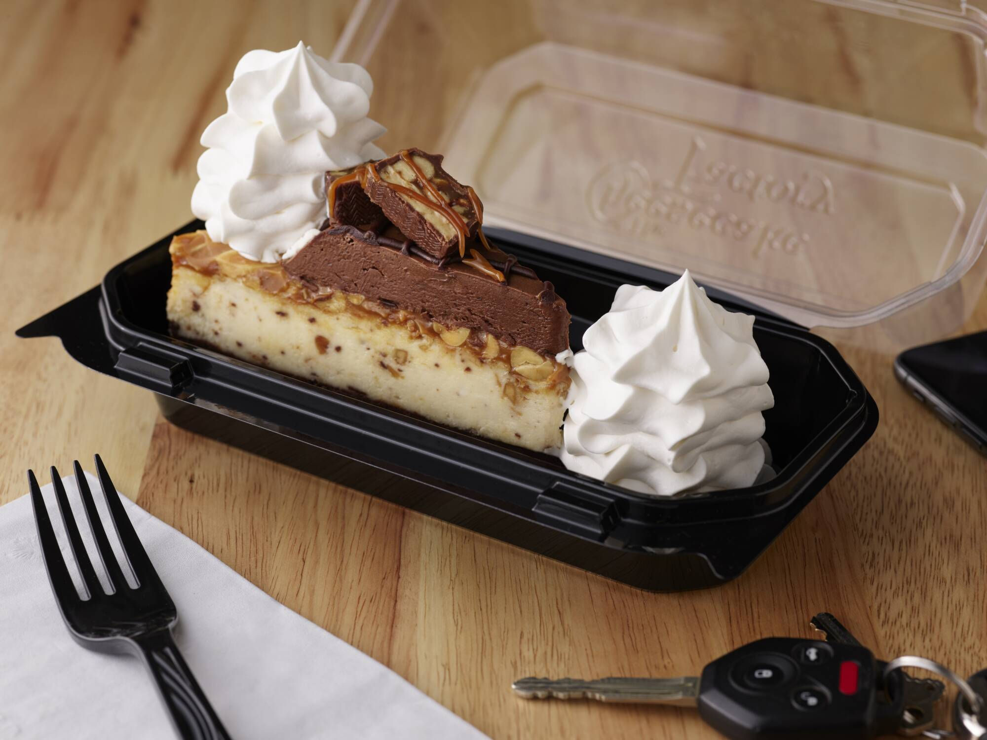 Enjoy Chocolate Carmelicious Cheesecake made with Snickers at Cheesecake Factory and support Freestore Foodbank!